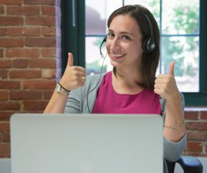 Woman Behind Computer Giving Thumbs Up Ways ADSTRA Can Make You Money Ways ADSTRA Can Make You Money